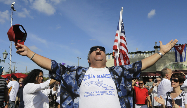A member of the Cuban community reacts to the death of Fidel Castro, Saturday, Nov. 26, 2016, in the Little Havana area in Miami. (Alan Diaz/AP)