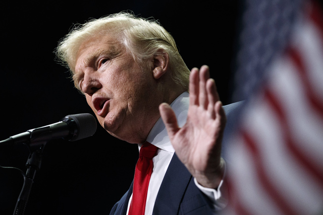 FILE - In this Nov. 4, 2016, file photo, Donald Trump speaks in Hershey, Pa. President-elect Trump holds stock in the company building the disputed Dakota Access oil pipeline, and pipeline opponen ...