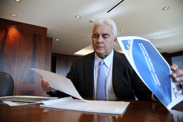 FILE - In this Friday, Nov. 18, 2016, file photo, Energy Transfer Partners CEO Kelcy Warren reviews documents at his office in Dallas on the Dakota Access oil pipeline that is mired in controversy ...