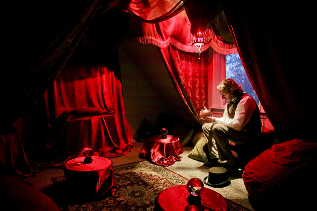 In a Saturday, Nov. 19, 2016 photo, Benjamin Lee-Roche sits in the divination room of his academy of magical arts at his home in Springville. The Blackburn Academy of the magical arts was built by ...