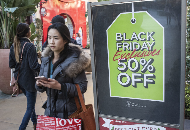 Shoppers look for deals at the Irvine Spectrum Center in Irvine, Calif., on Black Friday, Nov. 25, 2016. (Nick Agro/The Orange County Register via AP)