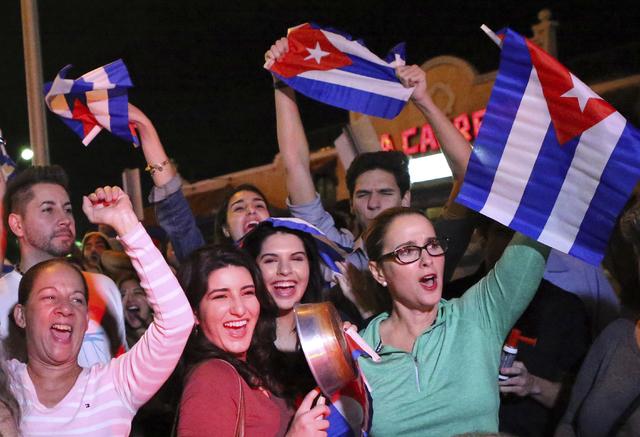 The Cuban community in Miami celebrates the announcement that Fidel Castro died. (David Santiago/El Nuevo Herald via AP, File)