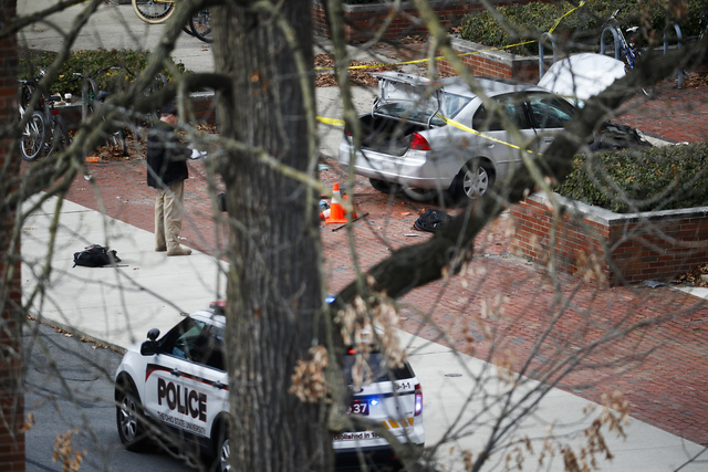 A car inside a police line sits on the sidewalk as authorities respond to an attack on campus at Ohio State University, Monday, Nov. 28, 2016, in Columbus, Ohio. (John Minchillo/AP)