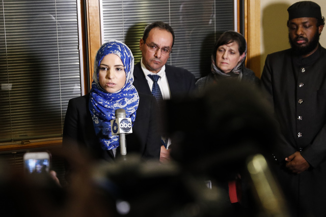 Roula Allouch, board chair of the Council On American-Islamic Relations, left, speaks during a news conference regarding an earlier attack at the Ohio State University campus, Monday, Nov. 28, 201 ...