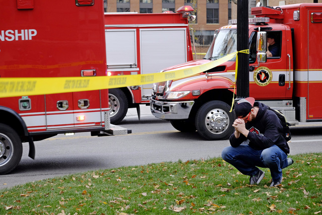 Student Nicholas Flores reacts as police respond to an attack on campus at Ohio State University on Monday, Nov. 28, 2016, in Columbus, Ohio. Multiple people were injured in the attack and a suspe ...