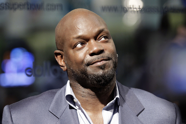 """This Feb. 3, 2010 file photo shows former Dallas Cowboys running back and contestant on """"Dancing with the Stars"""" Emmitt Smith during an interview at the Super Bowl XLIV media center in Fort Lauder ..."""