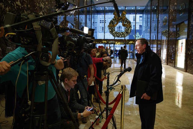 Former CIA director retired Gen. David Petraeus arrives at Trump Tower talks with reporters after a meeting with President-elect Donald Trump, Monday, Nov. 28, 2016, in New York. (Evan Vucci/AP)e