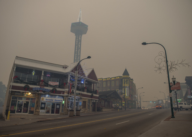 Thick smoke from area forest fires looms in Gatlinburg, Tenn., Monday, Nov. 28, 2016. Gatlinburg officials say several areas are being evacuated as a result of fires in and around Great Smoky Moun ...