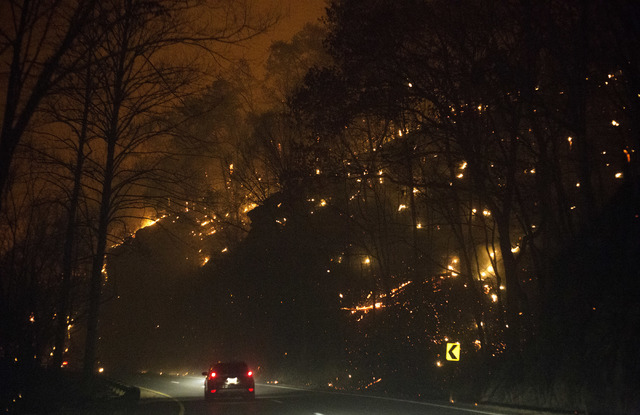 Fire erupts on both side of Highway 441 between Gatlinburg and Pigeon Forge, Tennessee, Monday, Nov. 28, 2016. In Gatlinburg, smoke and fire caused the mandatory evacuation of downtown and surroun ...