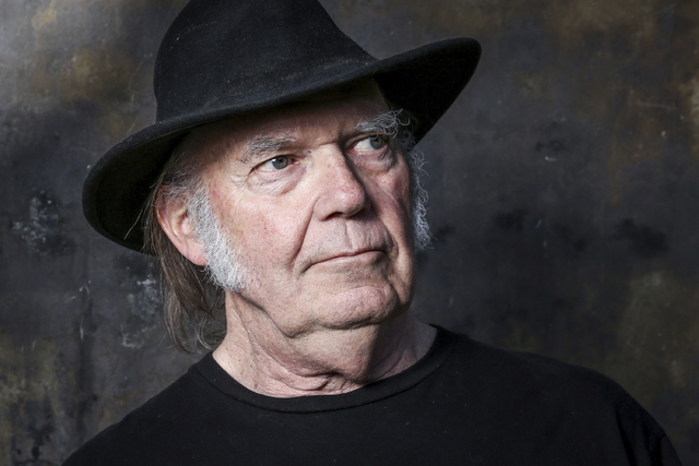 "FILE - In this May 18, 2016, file photo, Neil Young poses for a portrait in Calabasas, Calif., to promote his new album, ""Earth."" Young penned an open letter on Facebook posted o ..."