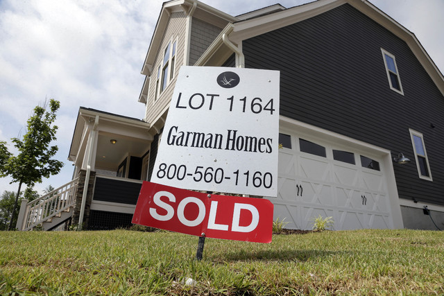 FILE - In this June 9, 2015, file photo, a sold sign is displayed in the yard of a newly-built home in the Briar Chapel community in Chapel Hill, N.C. On Tuesday, Nov. 29, 2016, the Standard & ...