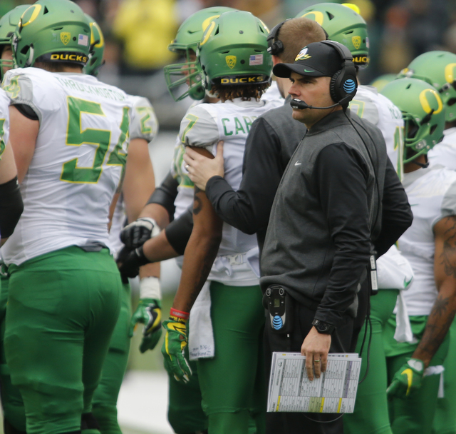 In this Nov. 26, 2016, file photo, Oregon head coach Mark Helfrich looks on in the first half an NCAA college football game against Oregon State, in Corvallis, Ore. Oregon's 34-24 loss to the Oreg ...