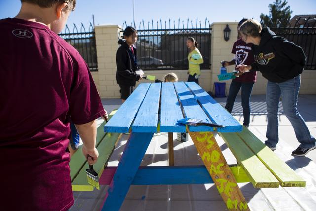 Faith Lutheran Middle Schoolճ students help paint a picnic table at 9th Bridge School in downtown Las Vegas, on Friday, Nov. 18, 2016. Miranda Alam/Las Vegas Review-Journal Follow @miranda_alam