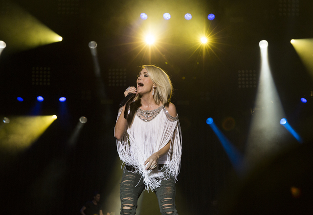 "Carrie Underwood performs during the first day of the American Country Music's ""Party for a Cause,"" event at the Las Vegas Festival Grounds on Friday, April 1, 2016 in Las Vegas. (Benjamin Hager/L ..."