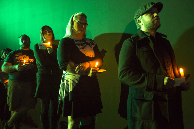 Attendees wait to read the names of victims who were killed due to anti-transgender hatred or prejudice during a Transgender Day of Remembrance vigil held at The Space on Sunday, Nov. 20, 2016. Ri ...