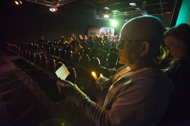 Kristen Stephens, 60, prepares to read the name of a victim killed due to anti-transgender hatred or prejudice during a Transgender Day of Remembrance vigil held at The Space on Sunday, Nov. 20, 2 ...