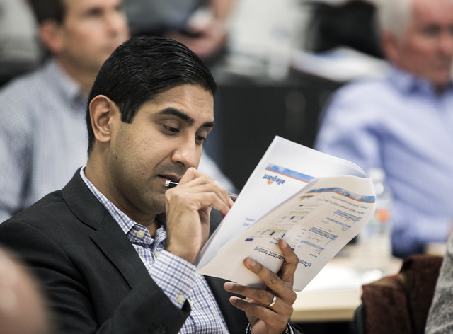 Morgan Stanley analyst Rajeev Lalwani views a handout during Allegiant Investors Day at the company's headquarters, 1201 N. Town Center Drive in Summerlin, on Tuesday, Nov. 29, 2016. About 40 airl ...