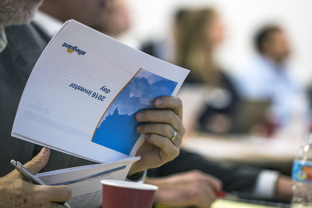 Airline analyst  views a hand out during Allegiant Investors Day at the company's headquarters, 1201 N. Town Center Drive Summerlin, on Tuesday, Nov. 29, 2016. About 40 airline analysts attend the ...