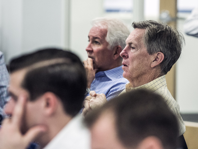 John Redmond, left, president and director of Allegiant and Maurice J. Gallagher, chairman and CEO, listens during Investors Day at the company's headquarters, 1201 N. Town Center Drive in Summerl ...