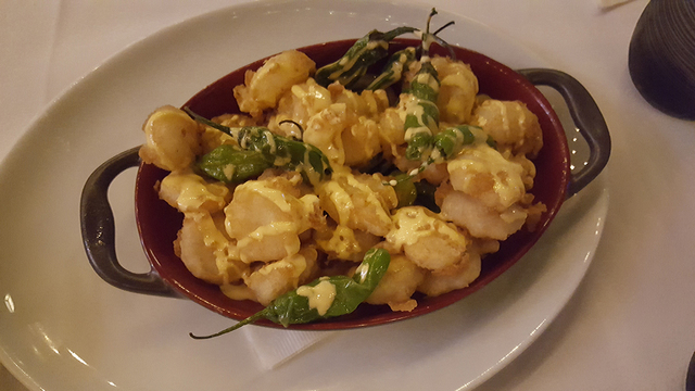 Rock shrimp fried in ale batter with shishito peppers and Sriracha cream at The Angry Butcher inside Sam's Town's Mystic Falls park, 5111 Boulder Highway, Oct. 9, 2016. Anne King/View