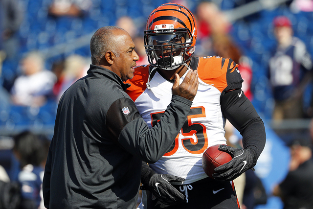 In this Oct. 16, 2016, file photo, Cincinnati Bengals head coach Marvin Lewis talks with outside linebacker Vontaze Burfict before their NFL football game against the New England Patriots at Gille ...