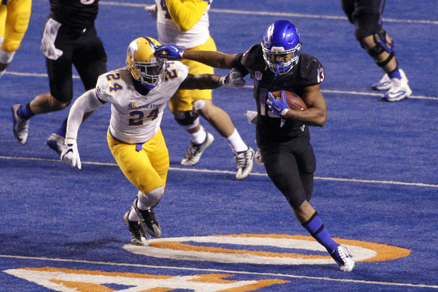 Boise State running back Jeremy McNichols (13) runs the ball past San Jose State cornerback Dominic Barnes (24) during the second half of an NCAA college football game in Boise, Idaho, Friday, Nov ...