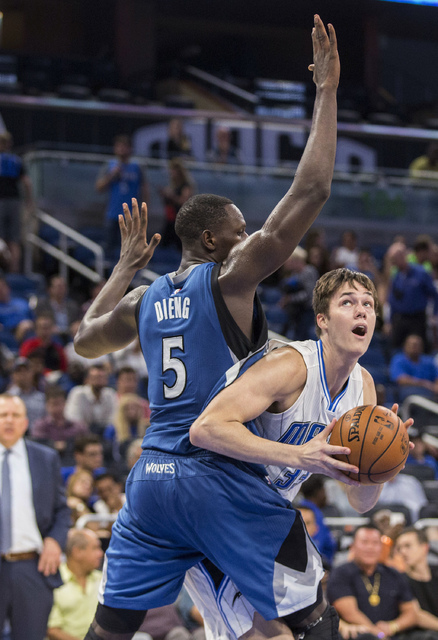 Orlando Magic center Stephen Zimmerman (33) attempts to get by Minnesota Timberwolves forward Gorgui Dieng (5) during the second half of an NBA basketball game in Orlando, Fla., Wednesday, Nov. 9, ...