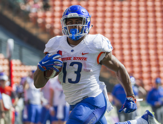 Boise State running back Jeremy McNichols (13) runs in for a touchdown in the first half of an NCAA college football game against Hawaii, Saturday, Nov. 12, 2016, in Honolulu. (Eugene Tanner/AP)