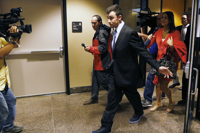 Heisman Trophy-winning quarterback Johnny Manziel leaves the Frank Crowley Courts Building, Thursday, Nov. 17, 2016, in Dallas. (David Woo/The Dallas Morning News via AP)