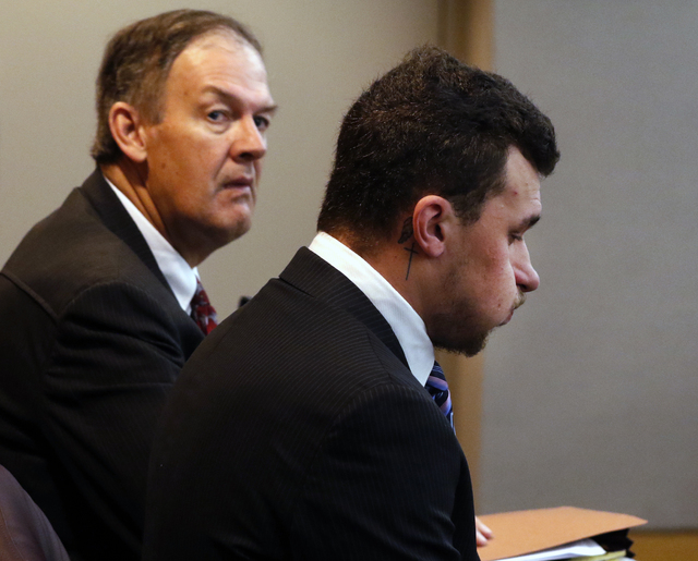Defense attorney Jim Darnell, left, waits with Heisman Trophy-winning quarterback Johnny Manziel before a hearing at the Frank Crowley Courts Building on Thursday, Nov. 17, 2016, in Dallas. (David ...