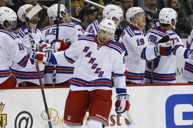New York Rangers' Rick Nash (61) celebrates with teammates after his goal in the second period of an NHL hockey game against the Pittsburgh Penguins in Pittsburgh, Monday, Nov. 21, 2016. (AP Photo ...