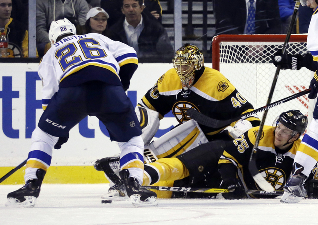Boston Bruins defenseman Brandon Carlo (25) drops down in front of goalie Tuukka Rask (40) as they defend against St. Louis Blues center Paul Stastny (26) in the second period of an NHL hockey gam ...