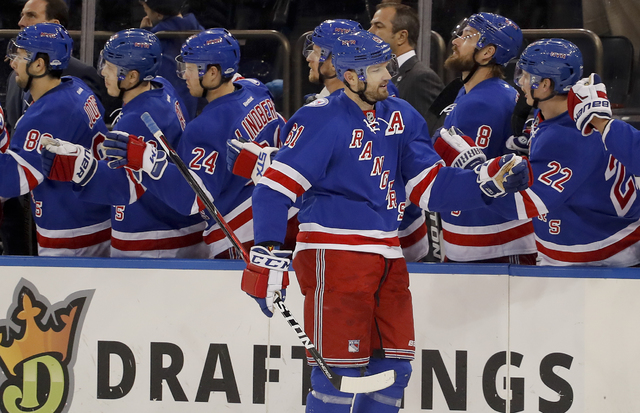 New York Rangers right wing Rick Nash (61) is congratulated by teammates after scoring against the Pittsburgh Penguins during the first period of an NHL hockey game, Wednesday, Nov. 23, 2016, in N ...