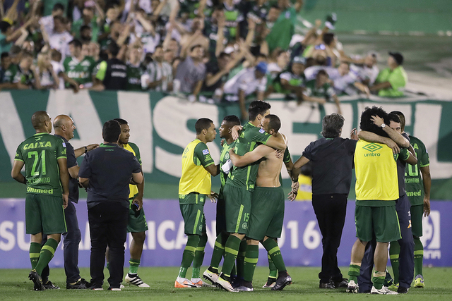 In this Wednesday, Nov. 23, 2016, file photo, players of Brazil's Chapecoense celebrate at the end of a Copa Sudamericana semifinal soccer match against Argentina's San Lorenzo in Chapeco, Brazil. ...