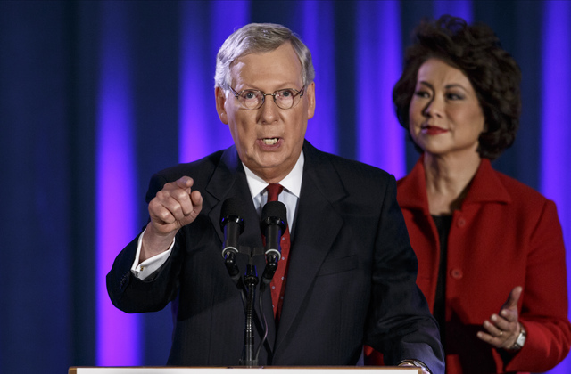 Senate Minority Leader Mitch McConnell of Ky., joined by his wife, former Labor Secretary Elaine Chao, celebrates with his supporters at an election night party in Louisville, Ky.,Tuesday, Nov. 4, ...