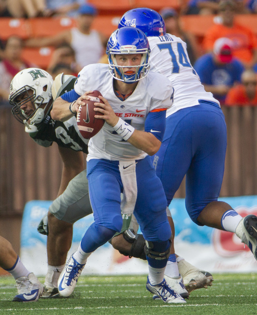 Boise State quarterback Brett Rypien (4) scrambles out of the backfield in the first half of an NCAA college football game against Hawaii, Saturday, Nov. 12, 2016, in Honolulu. (Eugene Tanner/AP)