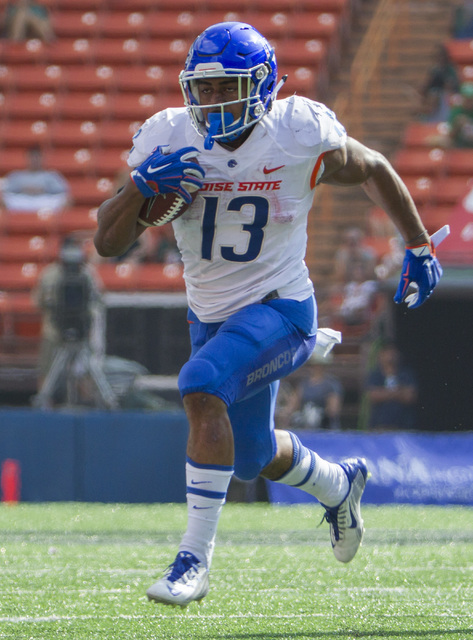 Boise State running back Jeremy McNichols (13) runs for a touchdown in the first quarter of an NCAA college football game, Saturday, Nov. 12, 2016, in Honolulu. (Eugene Tanner/AP)