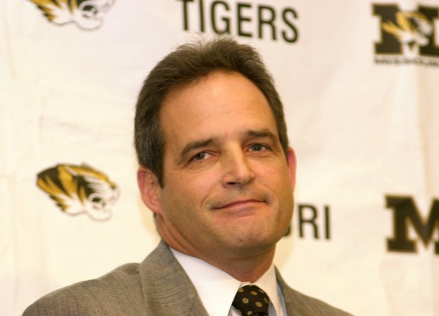 Gary Pinkel smiles to a crowd Thursday, Nov. 30, 2000, as he is introduced as the University of Missouri head football coach during a press conference in Columbia, Mo. Pinkel, who leaves Toledo, r ...