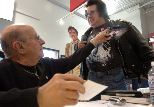 John Campolo, right, shows off his Elvis Presley buttons to Joe Esposito, a friend of Elvis who was in Kenosha, Wis., in January 2006, promoting his book. Esposito was Elvis' right-hand man, handl ...