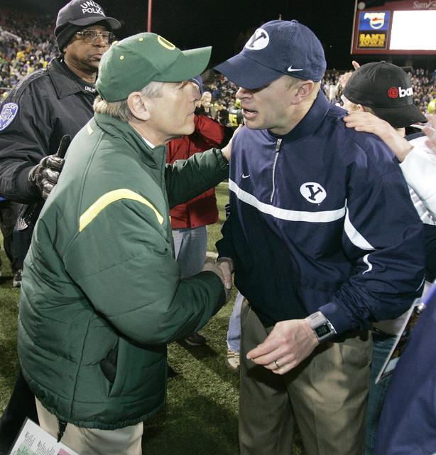 Oregon coach Mike Bellotti, left, congratulates Brigham Young coach Bronco Mendenhall following BYU's 38-8 win in the Las Vegas Bowl football game in Las Vegas on Thursday, Dec. 21, 2006. (AP Phot ...