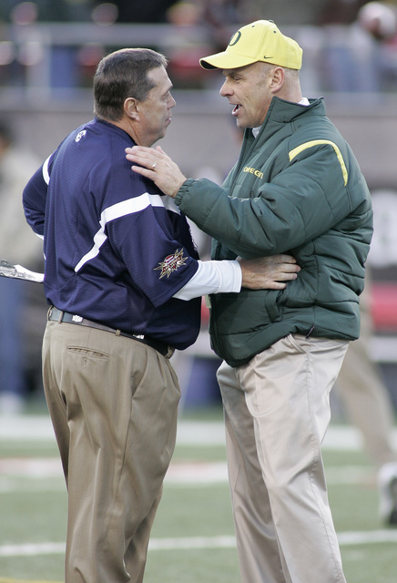BYU strength coach Jay Omer, left, chats with Oregon offensive coordinator Gary Crowton before the Las Vegas Bowl football game in Las Vegas on Thursday, Dec. 21, 2006. Crowton was the coach of BY ...