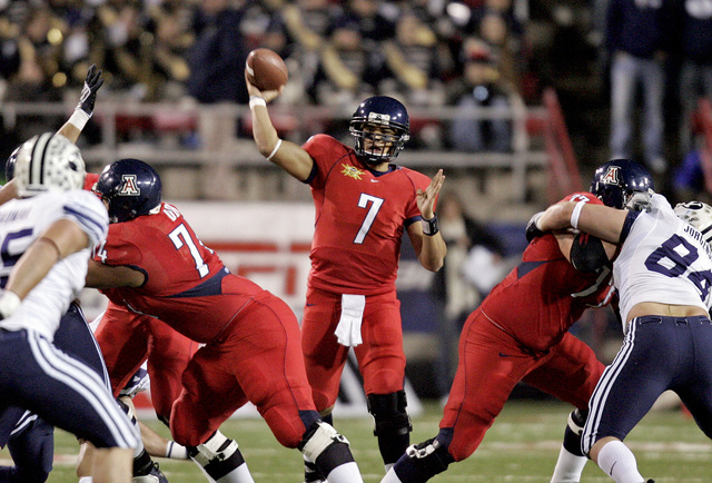 Arizona's Willie Tuitama passes the ball during the first half of the Las Vegas Bowl college football game against BYU on Saturday, Dec. 20, 2008. (Louie Traub/AP)