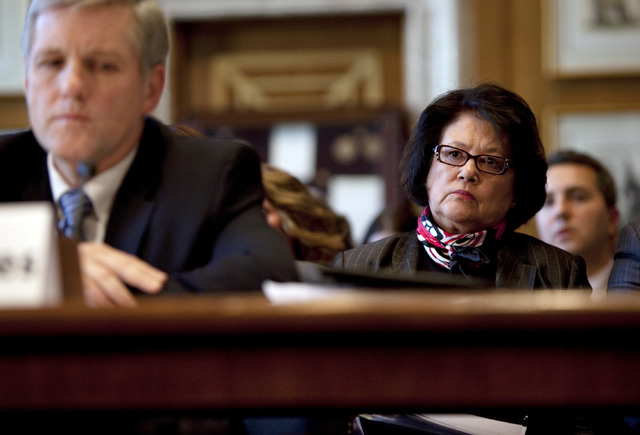 Elouise Cobell, right, looks on as Deputy Secretary of the Interior David Hayes testifies during a Senate Indian Affairs Committee hearing in Washington, D.C. on the multi-billion dollar Cobell v  ...