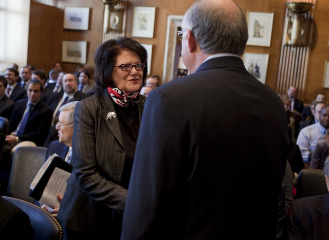 Elouise Cobell, left, shakes hands with Secretary of the Interior Ken Salazar before the start of a Senate Indian Affairs Committee hearing on the multi-billion dollar Cobell v Salazar law suit re ...