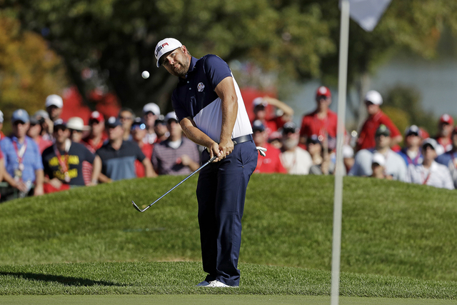 United States' Ryan Moore hits to the ninth hole during a singles match at the Ryder Cup golf tournament Sunday, Oct. 2, 2016, at Hazeltine National Golf Club in Chaska, Minn. (Chris Carlson/AP)