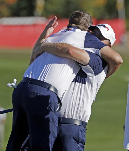 J.B. Holmes lifts Ryan Moore after the USA team won the Ryder Cup Sunday, Oct. 2, 2016, at Hazeltine National Golf Club in Chaska, Minn. (Chris Carlson/AP)