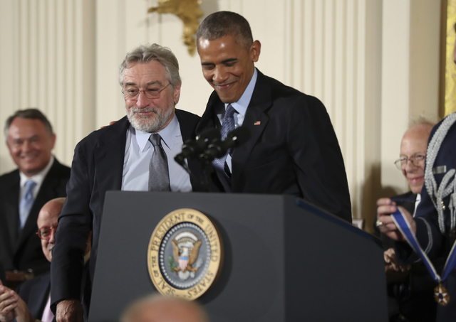 President Barack Obama presents the Presidential Medal of Freedom to actor Robert De Niro during a ceremony in the East Room of the White House Tuesday, Nov. 22, 2016, in Washington.  (AP Photo/Ma ...
