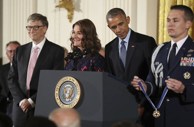 President Barack Obama presents the Presidential Medal of Freedom to Bill and Melinda Gates during a ceremony in the East Room of the White House Tuesday, Nov. 22, 2016, in Washington. Obama is re ...