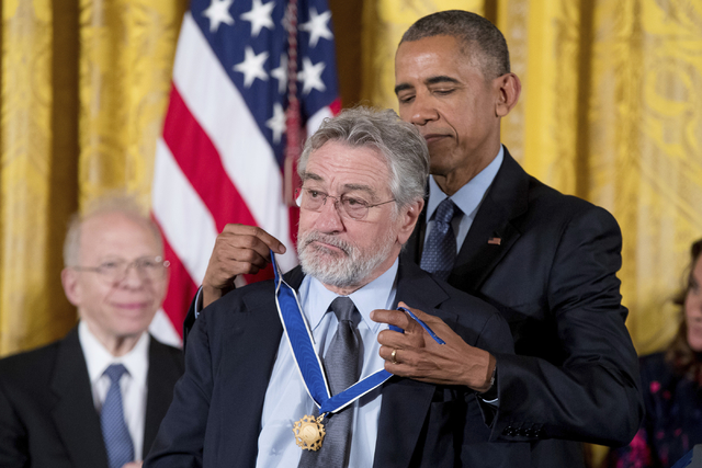 President Barack Obama presents the Presidential Medal of Freedom to Actor Robert De Niro during a ceremony in the East Room of the White House, Tuesday, Nov. 22, 2016, in Washington. Obama is rec ...