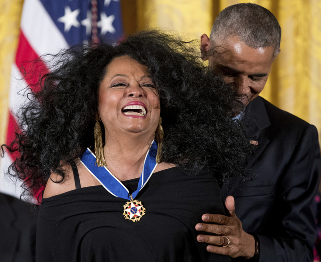 President Barack Obama presents the Presidential Medal of Freedom to singer Diana Ross during a ceremony in the East Room of the White House, Tuesday, Nov. 22, 2016, in Washington. Obama is recogn ...